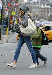 Sarah Jessica Parker walked her son James to school toting a Mahina bag in a soft cream  color.