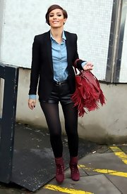 A classic black blazer dressed up Frankie Sandford's edgy look at the London Studios.