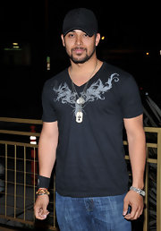 Wilmer Valderrama attended the Scarlet Series launch party wearing a black logo cap.