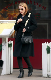 Scarlett Johansson accessorized her classic winter-wear with a black snakeskin satchel.
