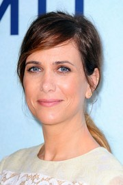 Kristen Wiig opted for a messy ponytail when she attended the Sydney premiere of 'The Secret Life of Walter Mitty.'