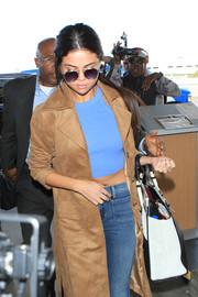 Selena Gomez accessorized with a pair of round shades by Simon Miller x Moscot for a flight out of LAX.