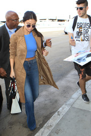 Selena Gomez teamed her jeans with a sky-blue cropped tank by Truly Madly Deeply.