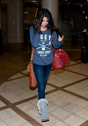 Selena topped off her look with baby blue sheepskin boots.