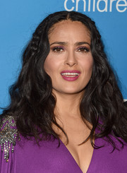 Salma Hayek wore her hair in voluminous, partially braided waves at the 2018 UNICEF Ball.
