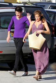 Stephanie Seymour paired an oversized straw tote with an airy dress for a summer feel while out and about with her son.