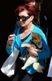 Sharon Osbourne topped her maxi dress with a lace jacket as she walked around NYC with her dog.