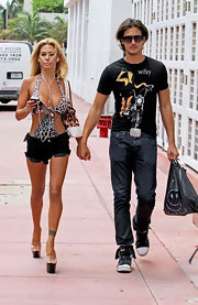 Shauna Sand looked summer-ready in black cutoffs and a leopard-print monokini while out and about in Miami.