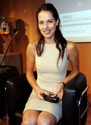 Ana Ivanovic showed off her slim figure in a nude sheath dress during a press conference.