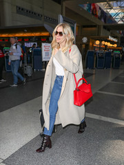 For a bright pop of color, Sienna Miller accessorized with a red cross-body tote.