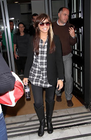 Knee-high black leather boots finished off Christina's effortlessly casual ensemble.
