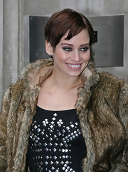 Kimberley was all smiles at the BBC radio station in her furry-coat. She decided to give her pixie haircut a classic look and sported a short side part.