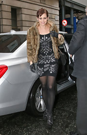 Kimberly stayed warm in the frigid weather in London in her fur coat. She paired her coat and black leggings with a chic pair of leather gloves.