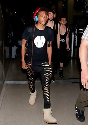 Jaden Smith paired nude sheepskin boots with zebra-print harem pants for his flight to LA.