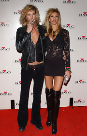 Susan Holmes wore black over-the-knee boots on the red carpet.