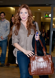 Brittany Snow's taupe button up blouse complemented her new red tresses.