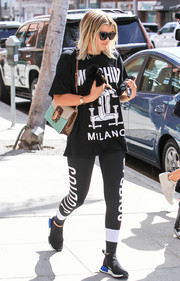 Sofia Richie added a touch of sophistication with a tricolor leather shoulder bag by Dolce & Gabbana.