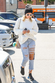 Sofia Richie kept it low-key in a white sweatshirt by Adidas Originals x Alexander Wang while running errands.