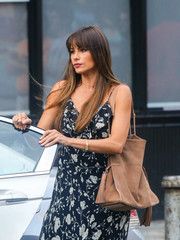Sofia Vergara ran errands carrying a tan suede bag with tassel accents.