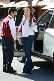 Sofia Vergara exuded '70s glamor in bell bottom jeans and a loose button up.