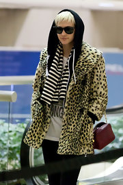 Ashlee dons a leopard print fur coat over her hoodie at the airport in LA.