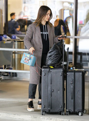 Sophia Bush accessorized with a cute robot-print box bag by Mark Cross during a flight.