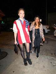 Instead of pants, Sophie Turner opted for a pair of sheer tights.