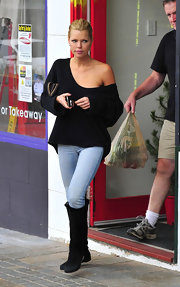 Sophie Monk got in some grocery shopping in a pair of black suede knee high boots.