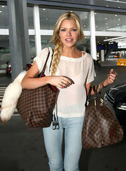 Sophie Monk wore her long tresses in a sweet side-swept braid while in Sydney, Australia.