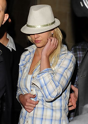 Britney Spears loves her fedora hats! She showed off one of her many caps at club Maddox wearing a plaid green fedora.