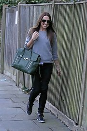 Mel C's green cross-body leather tote was a dressy finish to her casual get-up.