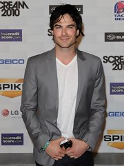 Ian looks smokin' in a gray pin stripe blazer of a v-neck tee.