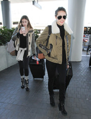 Sophia Stallone traveled in chic style wearing a fur-collar bomber jacket.