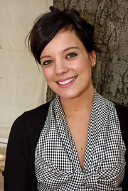 While attending a Dior fashion show, singing sensation Lily allen donned a messy up-do which she topped off with face framing bangs.