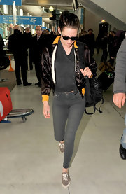 Kristen Stewart was retro cool in a faded graphic T-shirt and a silky bowling style jacket.