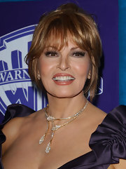 Raquel Welch had her locks pinned up in a messy updo for the Golden Globe party.