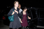Taylor is seen here with Selena Gomez rockin a green leather shoulder bag.