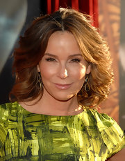 Jennifer Grey looked fierce on the 'Thor' red carpet wearing her hair in a voluminous feathered flip.