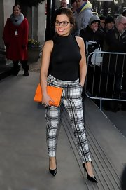 Rachel Shenton paired a classic sleeveless fitted blouse with plaid pants for a sophisticated and preppy look.