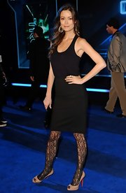 Summer makes her patterned tights stand out with a simple black dress and nude peep toe pumps.