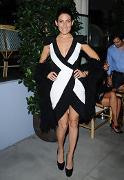 Lisa looks cutting edge in a black and white cocktail dress with daring shoulder pads.