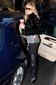 Taylor Armstrong covered up in NYC with a black fur chubby jacket and an argyle sweater.