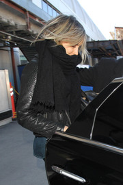 Taylor Schilling looked toasty wearing this black scarf and leather jacket combo at LAX.