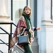 Taylor Swift's Plaid Poncho and Green Jeans