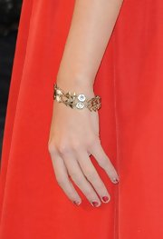 Taylor added a little glitz and glam to her look with this golden floral-and-geometric bracelet.