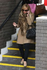 Emma Bunton jazzed up her classic camel coat with a leopard print scarf and teal bag.