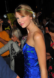 Taylor accessorizes with this cute head band which girls her pinned back curls a fun and girly look.