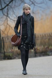 Taylor Swift topped off her winter style with black leather oxfords.
