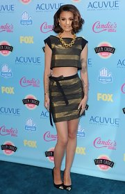 Cher Lloyd bared her tummy with this bronze and black crop top and matching ribbon tie skirt.