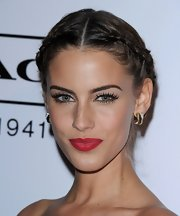 Jessica Lowndes wore a great pair of false lashes at the 9th Annual 'Teen Vogue' party. To recreate her retro look, sweep black liquid liner across the upper lid and line the inner rims with a black eye pencil. Next, add small beads of lash glue to the false lash strips and apply along the lash line. Finish the look with a few coats of mascara.